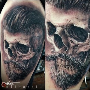 A realism black and grey tattoo of a greaser skull Tattoo by Brian Ulibarri